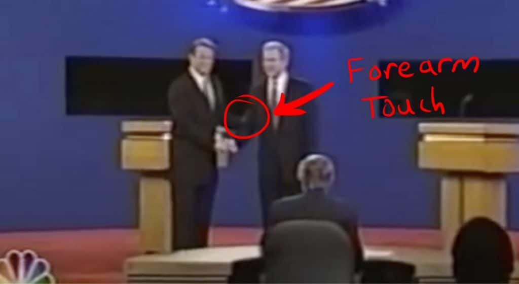 Gore touches Bush's forearm.