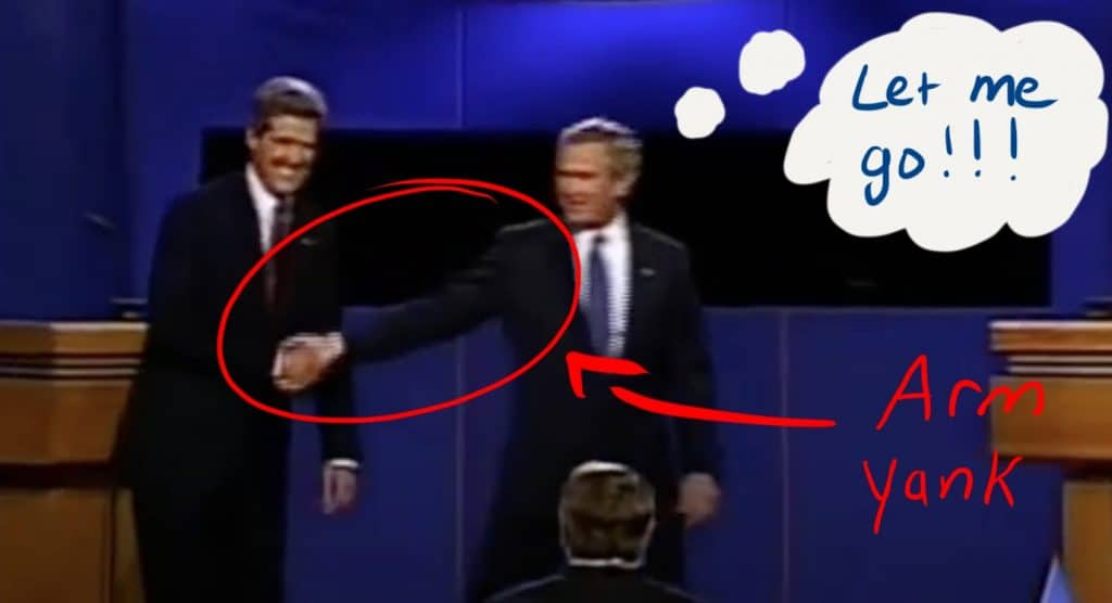 Bush yanks his arm away from Kerry.