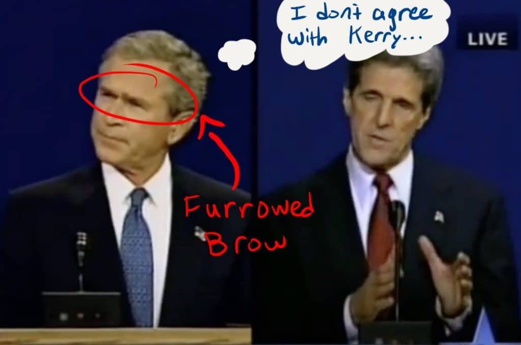 Bush furrows his brow, indicating that he disagrees with Kerry.
