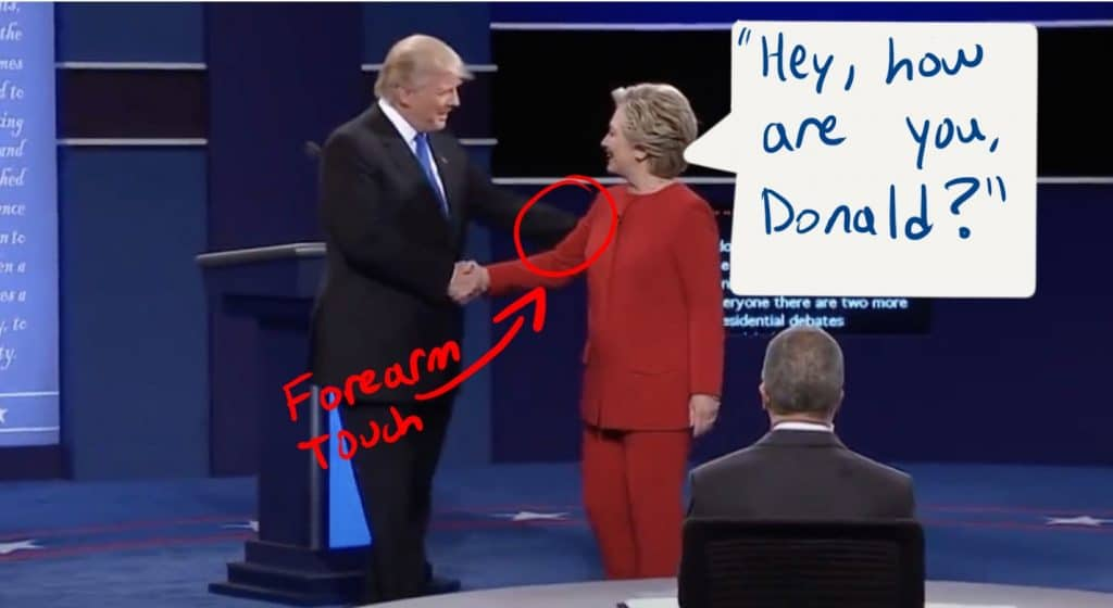 Trump shakes Clinton's hand as she verbally greets him.