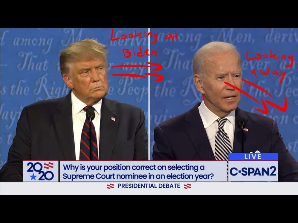 Trump holds his head up high while looking at Biden during Biden's speaking turn