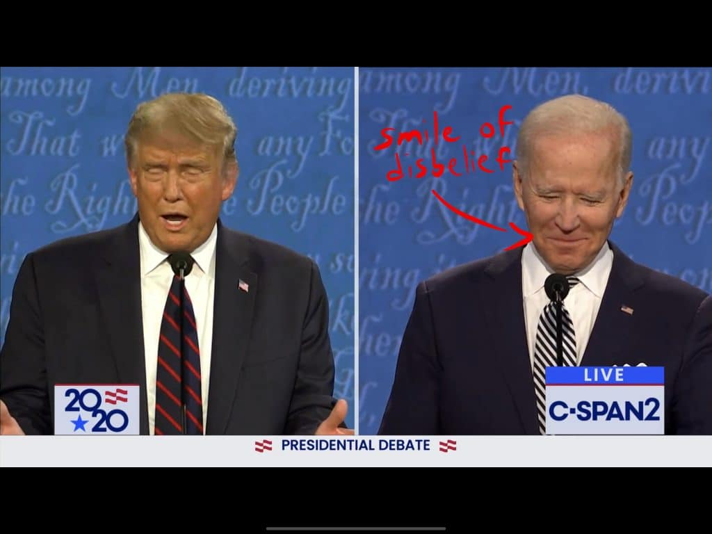 Biden smiles and shakes his head, disagreeing with Trump