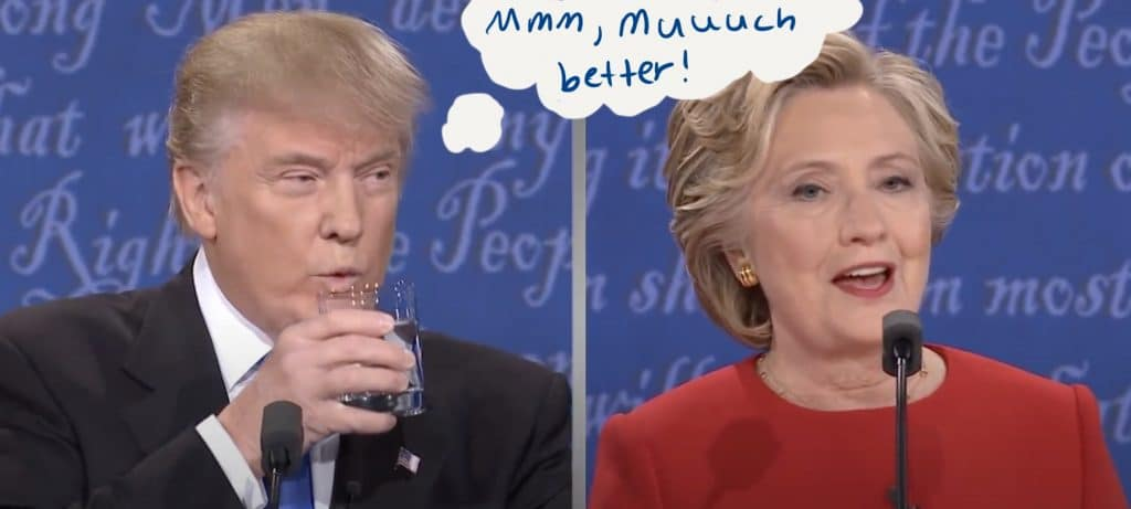 Trump drinks a glass of water while Clinton speaks.