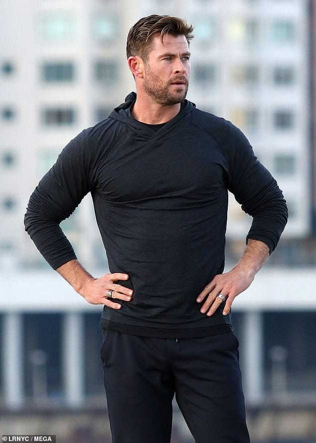 Chris Hemsworth posing with his hands on hips