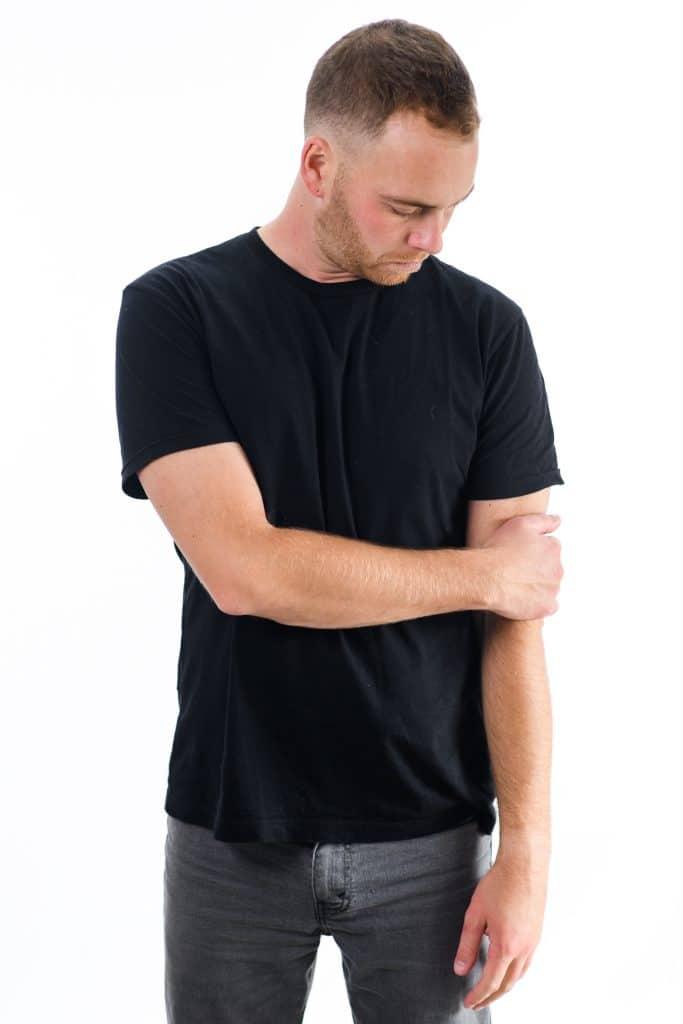 One Arm Cross Body Language Cue