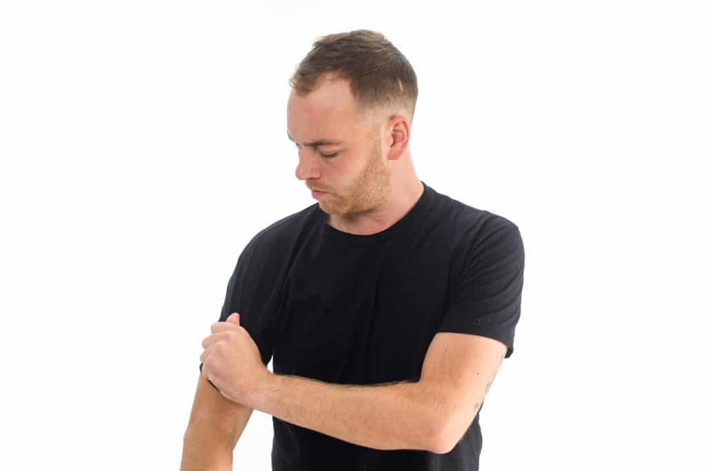 Arm Touching Body Language Cue