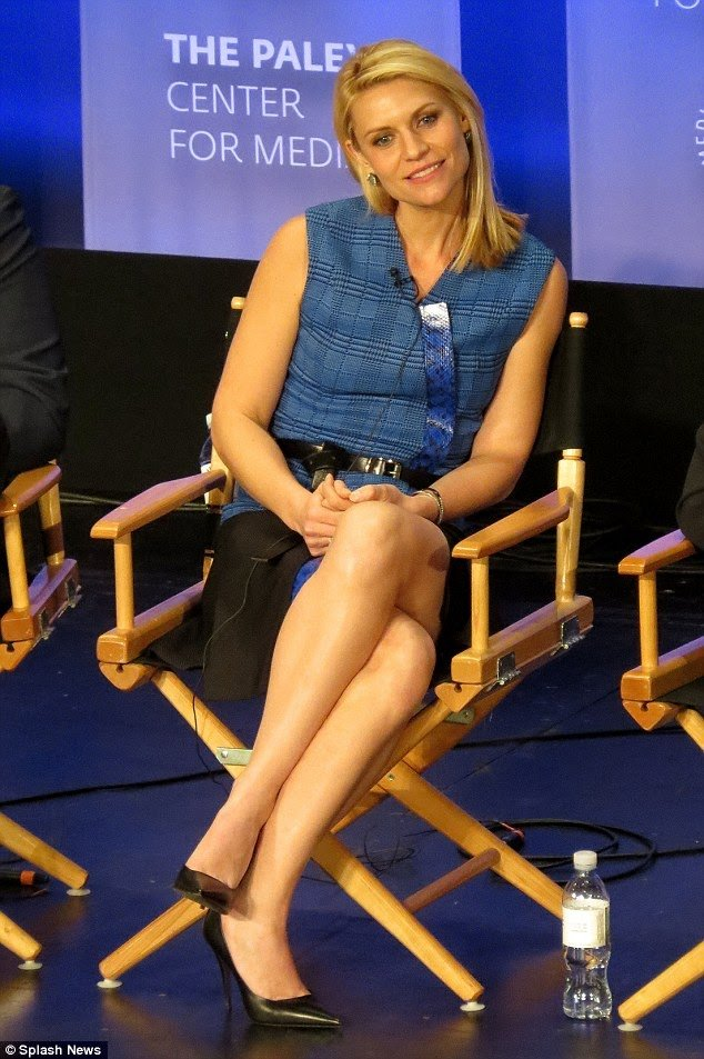 Claire Danes seated parallel legs