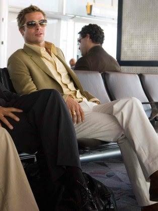 Brad Pitt crossing his legs in Ocean's Eleven