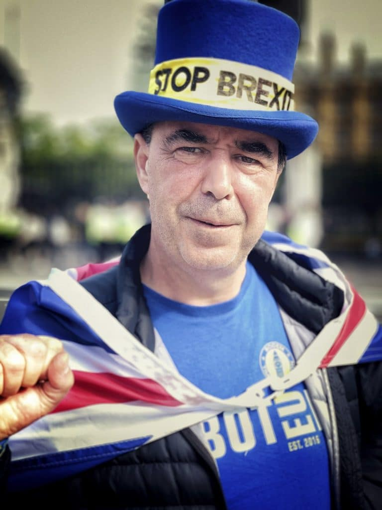 Steve Bray wearing a UK flag and a hat with Stop Brexit on it