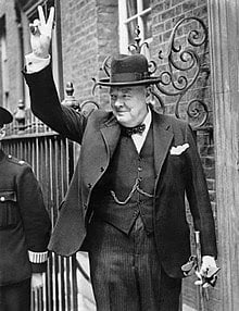 Winston Churchill making the a sign for victory during WWII
