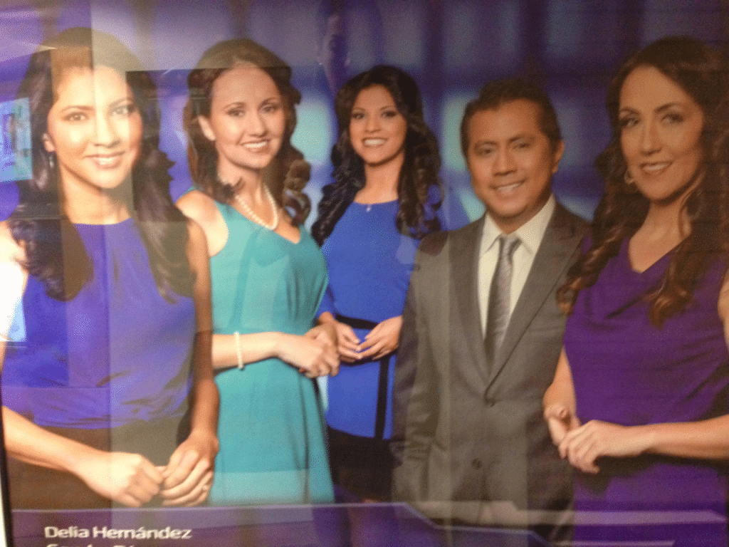 A picture of four women showing their hands but blocking their torsos with their arms and a man with hands in his pockets