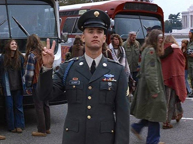 "Tom Hanks throwing up the ""Peace Sign"" while doing the soldier stance in the movie, Forrest Gump"