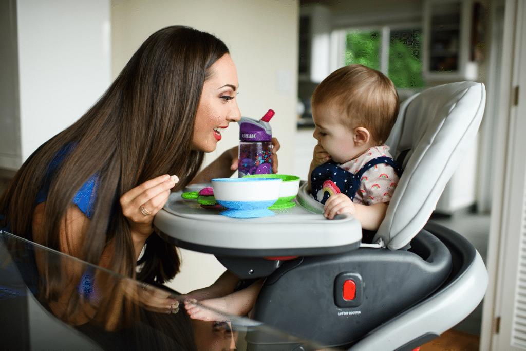 Vanessa Van Edwards feeding her little girl