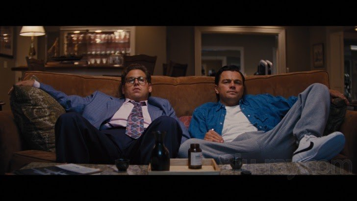 Jordan Belfort and Donnie Azoff spreading their legs wide in the movie The Wolf of Wall Street