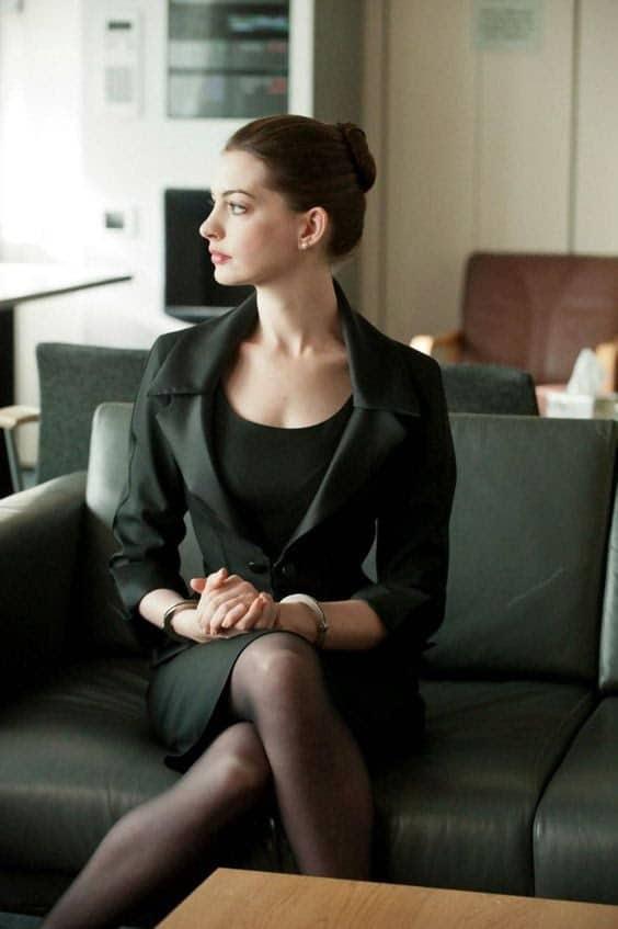 Anne Hathaway crossing her legs