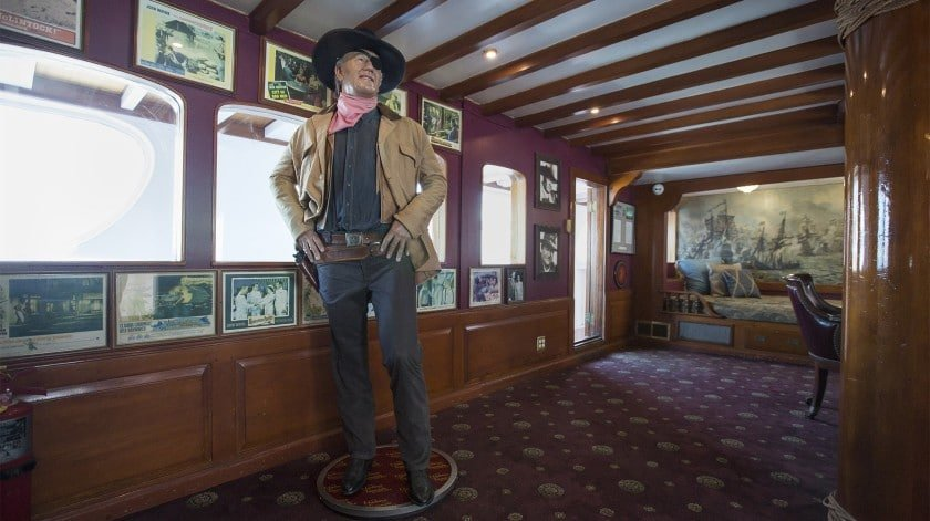 Cowboy standing in a belt buckle pointer positionstanding in a belt buckle pointer position