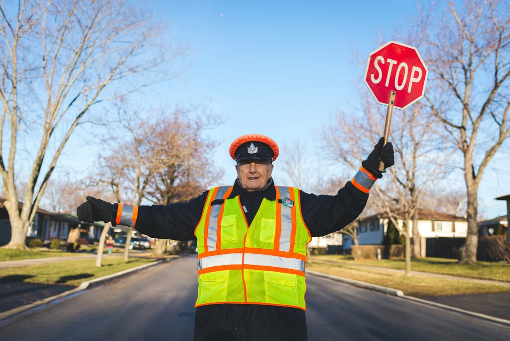 crossing guard showing Stop sign