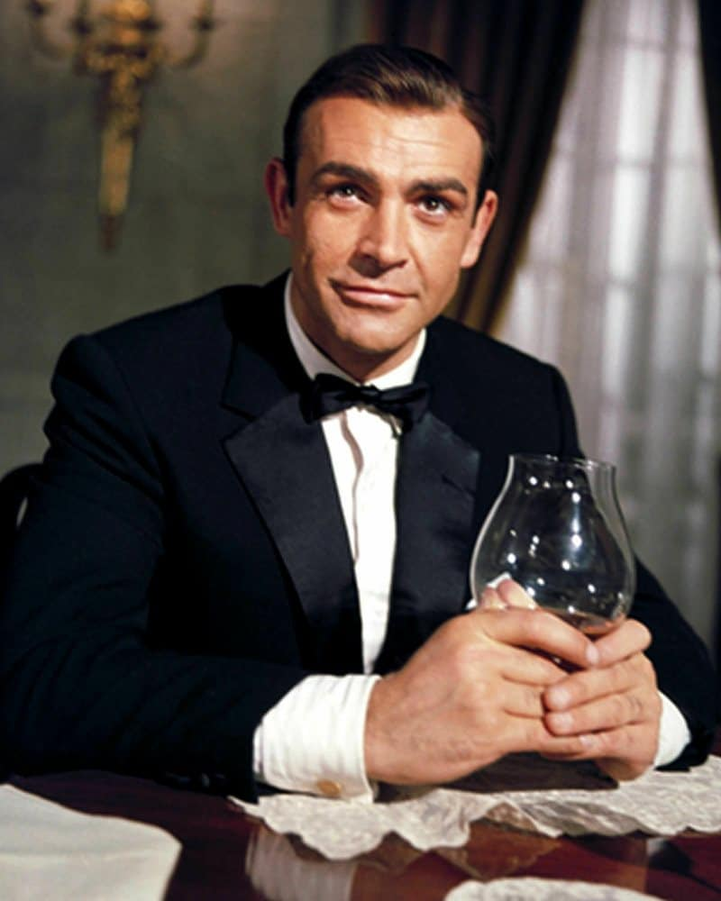 Sean Connery holding a glass in his hands