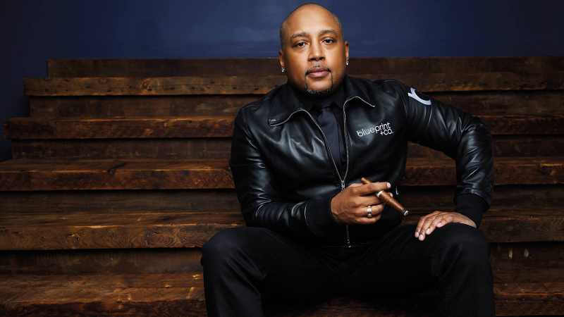 Daymond John in theseated-readiness position