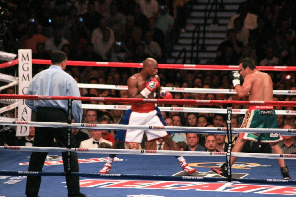 Floyd Mayweather, Jr. and Juan Manuel Márquez blading in the ring