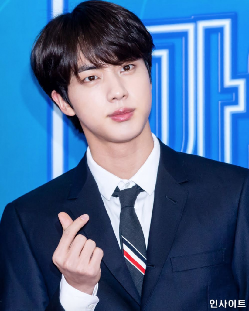 Jin from Korean pop group's BTS with his upturned-lips. Source