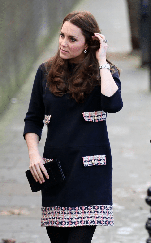 Confident body language: Kate Middleton tucking her hair behind her ears