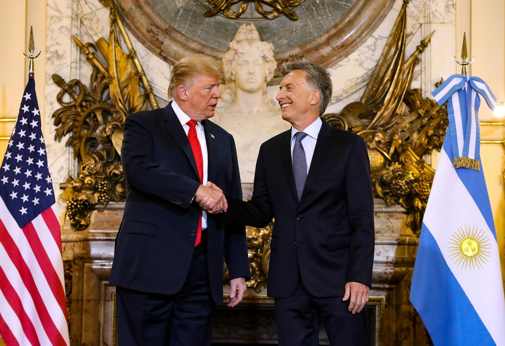 Donald Trump and Mauricio Macri shaking hands during the G20 summit in Buenos Aires