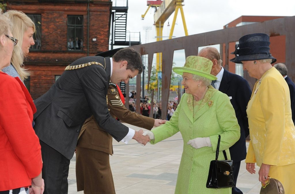 A proper forward-lean handshake with the Queen of England