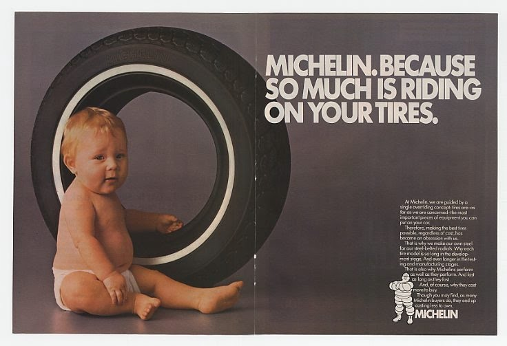 Old michelin ad showing a baby next to a tire