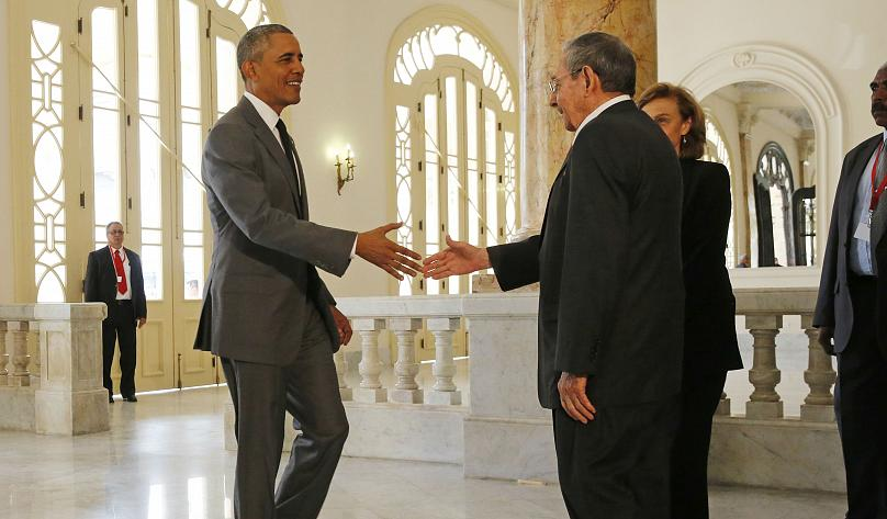 Former US President Barack Obama shakes hands with Cuba's President, Raul Castro