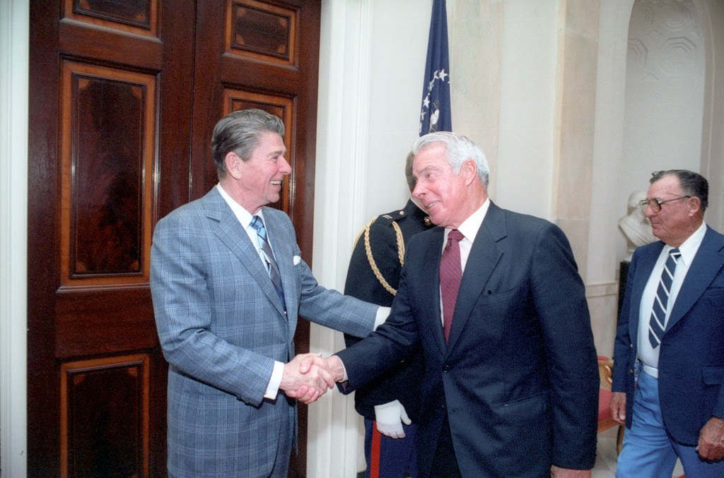 """Image of President Ronald Reagan getting the """"one-up"""" on Joe DiMaggio"""