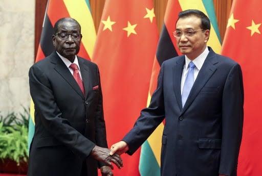 Zimbabwean President Robert Mugabe meets Chinese Premier Li Keqiang