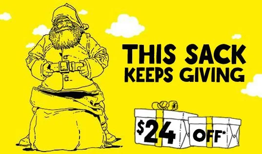 Spirit airlines ad image showing santa with a large sack between his legs