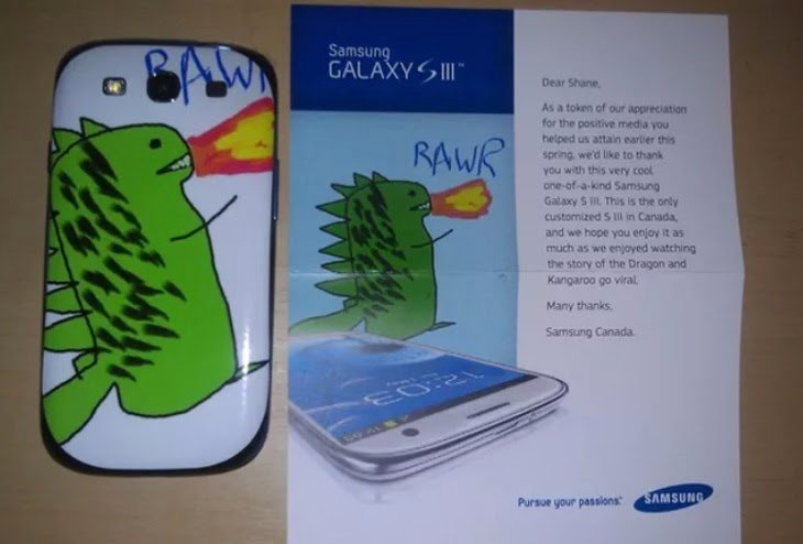 A Samsung S3 phone with a dragon drawing on it