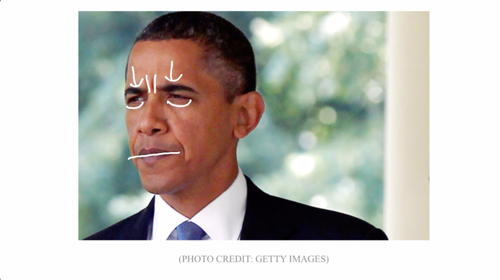 Barack Obama furrowing his brow, hardening his eyelids, and pursing his lips.