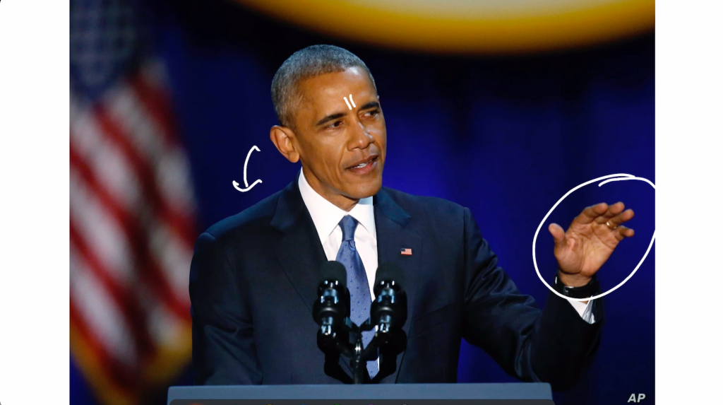 Barack Obama using the palms down gesture and tilting his head slightly downward