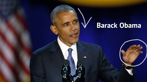 Barack Obama giving a palm down hand gesture and tilting his head slightly downwards